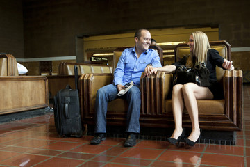 Couple sitting together in train station