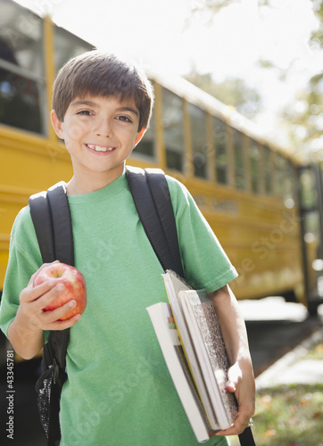 Caucasian boy waiting for school bus