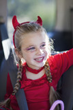 Caucasian girl in devil's costume