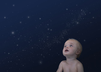 Caucasian baby looking at stars in the sky