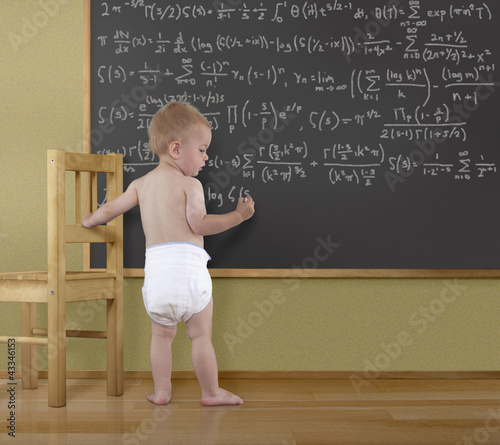Caucasian baby doing math on blackboard