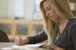 Caucasian teenage girl studying