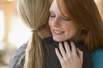 Caucasian teenage girls hugging