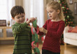 Boy and girl making Christmas paper chain