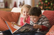 Children reading Christmas book together