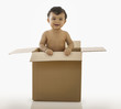 Mixed race baby boy in cardboard box