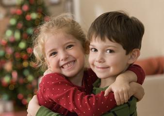 Girl and boy hugging on Christmas