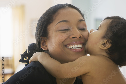 Mixed race mother hugging baby boy