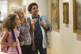 Grandmother and grandchildren visiting a museum