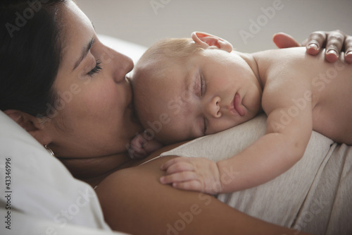 Hispanic mother holding baby girl