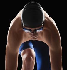 Caucasian teenage boy in swim cap and goggles