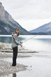 Caucasian woman fishing in Maligne Lake