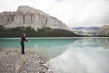 Caucasian woman fishing in Maligne Lake