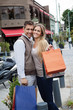 Cheerful Couple With Shopping Bags
