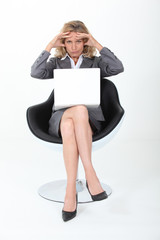 Businesswoman holding head
