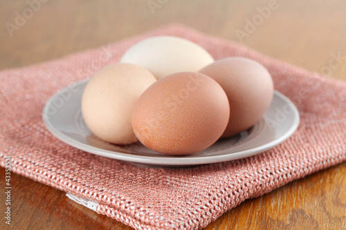 Organic chicken eggs on a plate