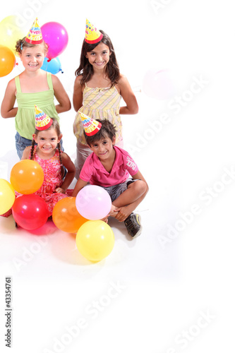 four kids at a party