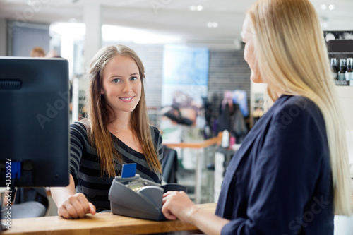 Female Sales Clerk At Counter