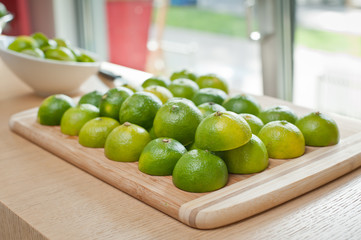 Fresh colorful, green limes limes on a tray