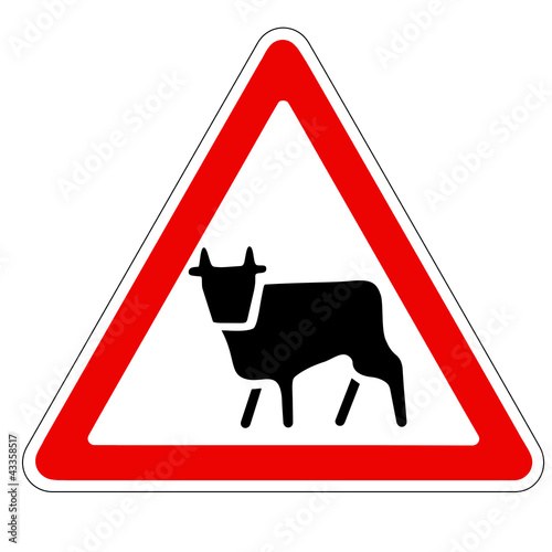 triangular traffic sign with a picture of a cow