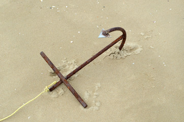 the big anchor on the sand beach