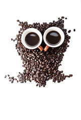 conteptual owl made with coffee beans
