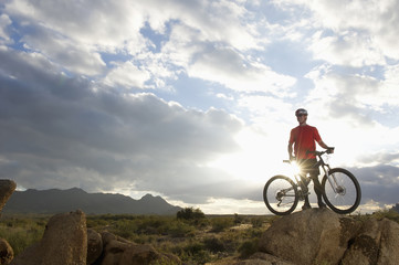 Caucasian man riding mountain bike in remote area