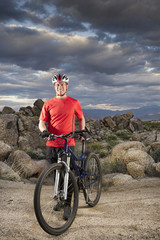Caucasian man with mountain bike in remote area