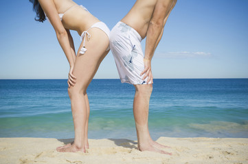 Caucasian couple standing together on beach