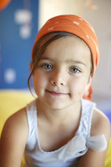 Mixed race girl wearing bandana