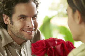 Hispanic man giving girlfriend roses