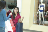 Hispanic friends shopping in shopping mall