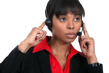 Woman wearing telephone head-set