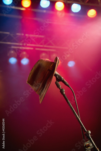 Fedora hanging on microphone on stage