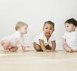Babies watching crying friend