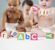 Babies playing with alphabet blocks
