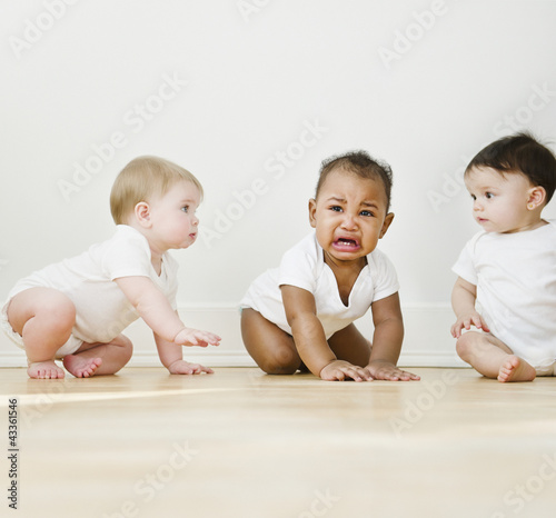 Babies watching crying friend