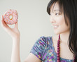Korean woman holding donut
