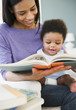 African American woman reading to baby boy