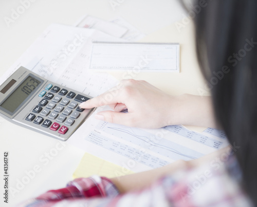 Korean woman using calculator