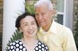 Smiling senior Chinese couple