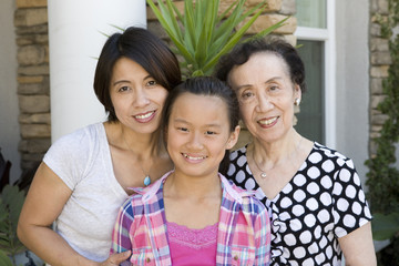 Smiling Chinese multi-generation family