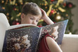 Caucasian boy reading Christmas story