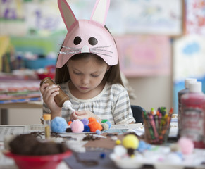 Caucasian making rabbit mask