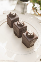 Three chocolate ganache petite cakes