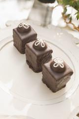 Three chocolate ganache petite cakes