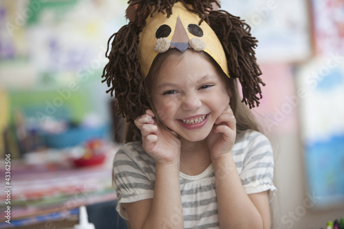 Caucasian girl making lion mask
