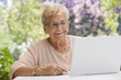 Senior Hispanic woman using laptop