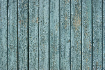 Old wooden fence, painted in blue.