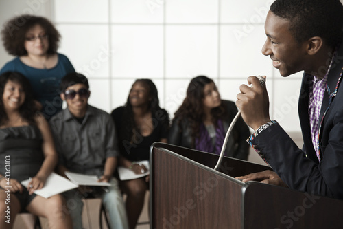 Teenage boy giving speech to classmates